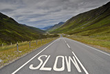 Slow sign on the road to Torridon, NW Scottish highlands poster