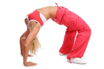 Athletic tanned girl in red sporive gear making a bridge