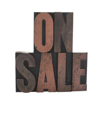 'on sale' in old wood letters