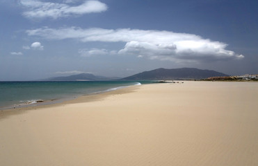 Sandy beach in Spain. Sky and clouds.