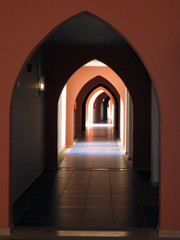 Infinite arches within arches form hallways