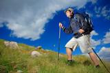 Hiker climbing a peak in national park Pirin, Bulgaria poster
