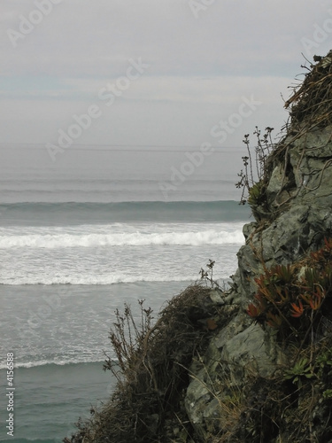 Looking out over the waves from a rocky shore