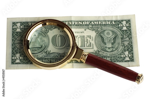 Dollar under a magnifier
