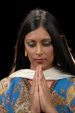 Indian lady in traditional attire praying poster