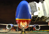 Southwest Airlines plane at the gate poster