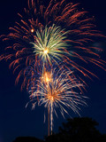 Multicolored fireworks bursts poster