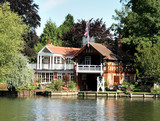 Riverside Dwelling and Boathouse on the Thames in England poster