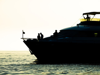 Motor boat in sunset