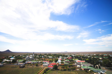 Blue sky over a dry desert town