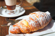 Early morning coffee and croissant