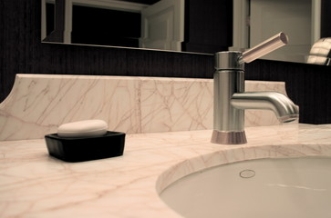 Modern Faucet and Sink with Soapdish in Elegant Restroom