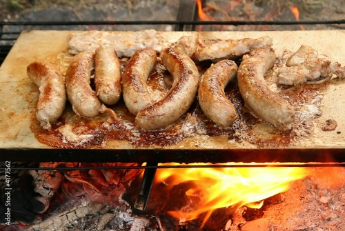 Roast meat - delicious dinner and sausage