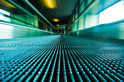 traveling on a moving escalator