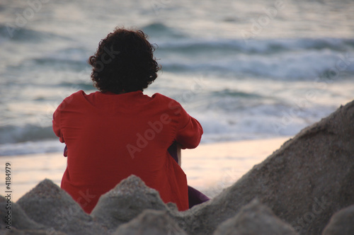 man in red on the sea shore