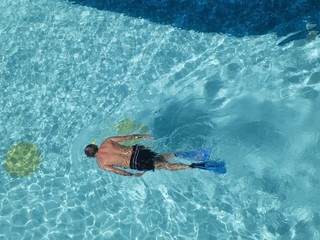 Man snorkeling in swimming-pool.