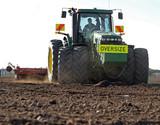 Large Tractor Preparing Soil poster