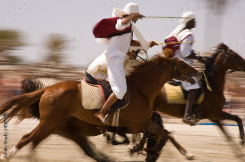 Fototapeta Horses exhibition at Djerba beach with panning technique