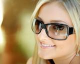 Fototapety Beautiful young blond  woman with sunglasses