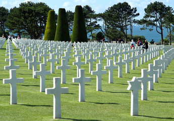 Visitors in Normandy american cemetery in front of Omaha Beach
