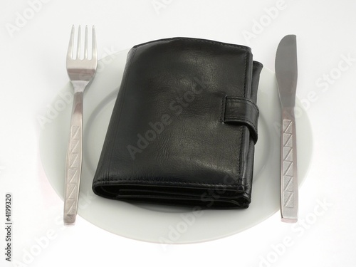 Black wallet on the plate