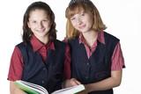 Two cute school girls. Uniformed schoolchildren. poster