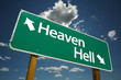 Heaven, Hell Road Sign with dramatic clouds and sky.