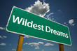 Wildest Dreams Road Sign with blue sky and clouds.