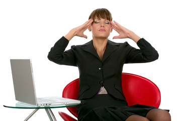 Business woman suffering from headache and pressing her head wit