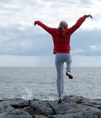 Woman exercising on cliff