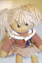 The doll with blond hair, the toy