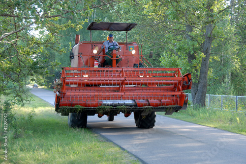 Poster Combine Harvester on the road