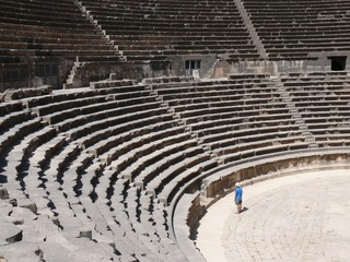 Ancient amphitheatre, rows of stairs and seats, Bosra, Syria