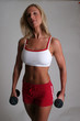 pretty blond with dumbbells