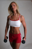 pretty blond with dumbbells poster
