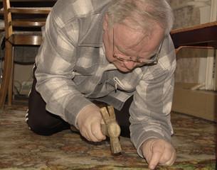 mature man fixes floor