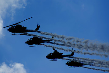 silhouetted helicopters