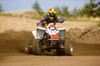 Young man on quadbike sliding