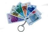 Keyring with euro notes, isolated on white background