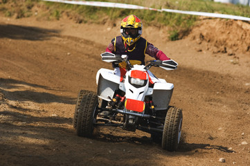 Young man on quadbike.