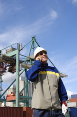 engineer with commercial port in background