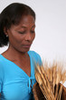 mature african american woman with wheat