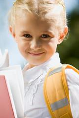 Portrait of a small schoolgirl