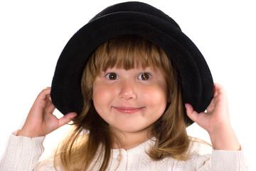 Pretty little girl in black hat