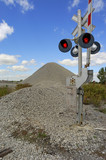 Stone pile near railroad signal poster