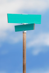 Blank street sign on blue sky