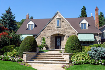 House with dormers and large stone gable