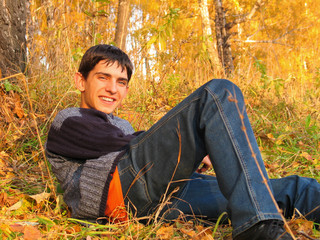 teen in autumn forest