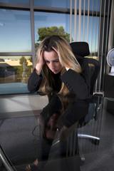 depressed at her desk