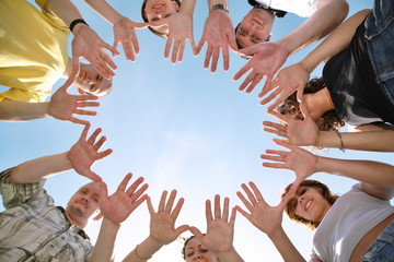 group of people make cyrcle from hands